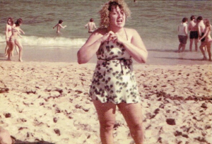 Mrs. Griffith singing on the beach, New Years Day, 1975